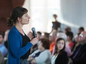 Miller speaking at Brown University, 9/13.